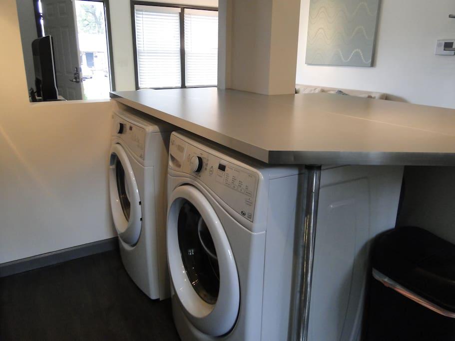 Washer and dryer cleverly hidden under kitchen island