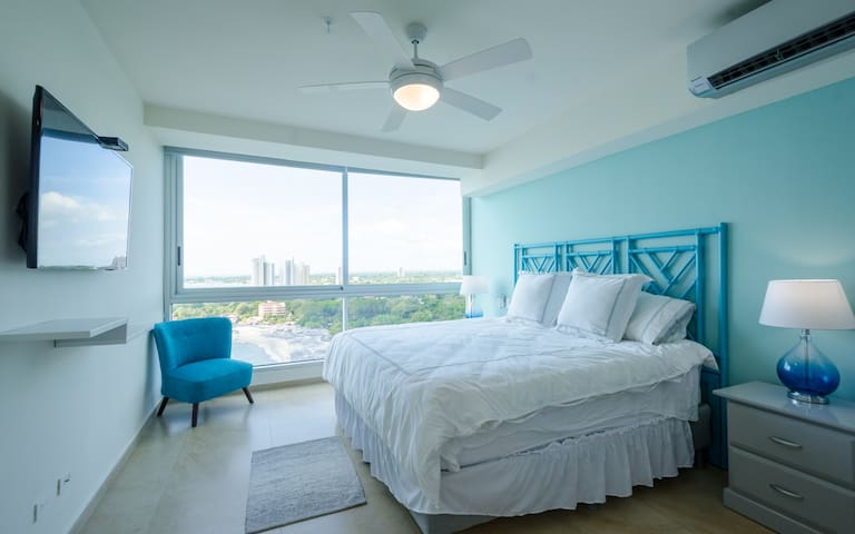 Beautiful master bedroom with King, AC, TV and incredible ocean and bay views!