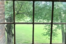 View of the grounds from one of the four large bedroom windows