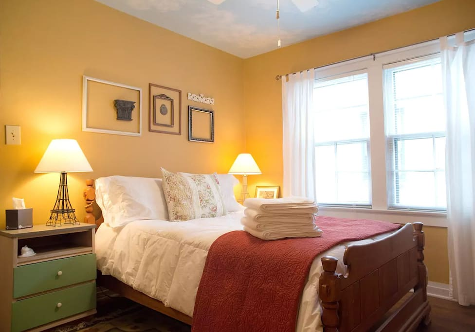 The main bedroom features a full sized bed with lots of feather and down pillows.