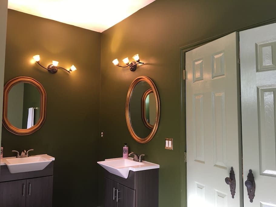 His & Hers Sinks with Antique Gilded Mirrors