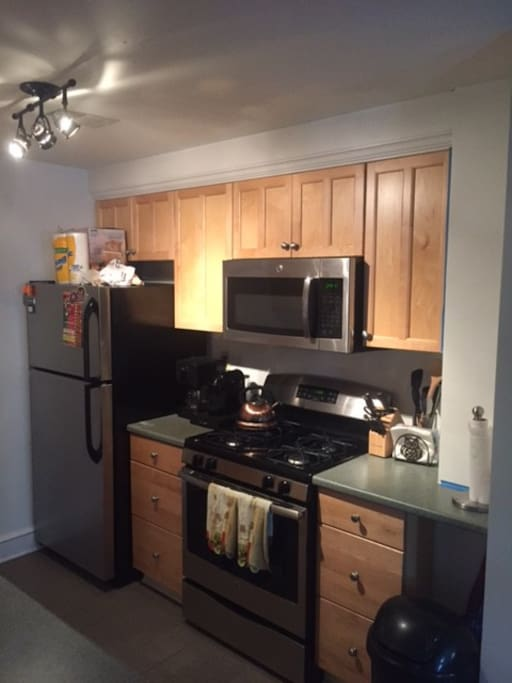 Brand new stainless steel appliances, track lighting, coffee pot & nespresso machine (includes coffee, filters & espresso pods)