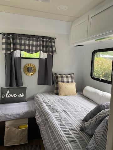 Twin bed in back