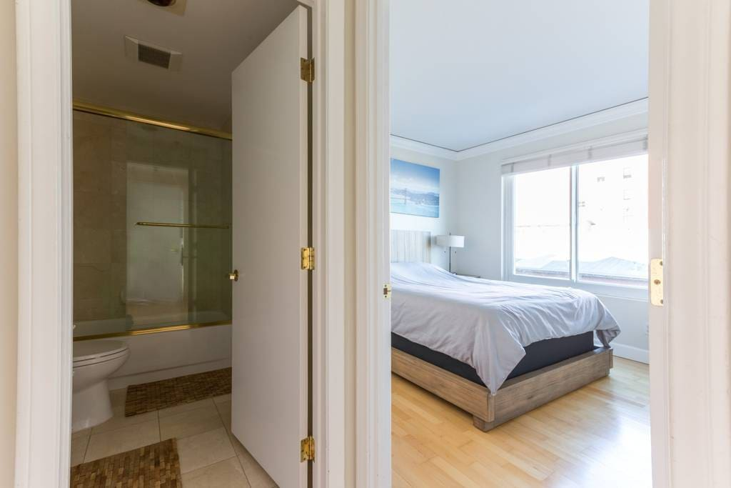Private ensuite bathroom. Door separates hallway from the rest of the condo.