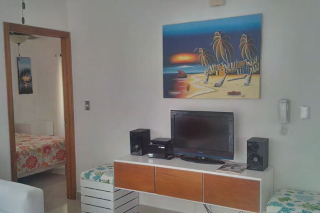 Living Room with TV, DVD player and stereo and ceiling fan