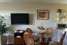 Dining Area, Hawaiian Tapa Artwork on the wall, open to the kitchen