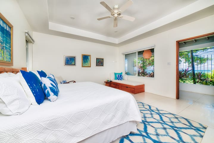 Bedroom #3      16x18 feet King bed and a sofa bed, en suite bathroom, a/c, ceiling fan, garden, pool, and turquoise Caribbean Sea views