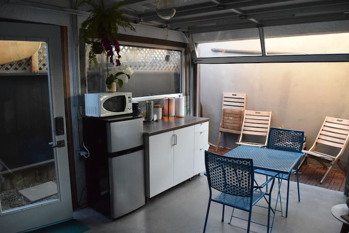 Kitchenette area, there is a sink to the left out of view