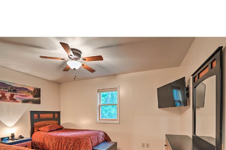 The second bedroom has two twin beds, ceiling fan, spacious dresser and mirror and a Roku TV with complementary Netflix, Amazon, Hulu, Disney+ and ESPN+.