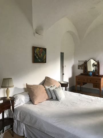Main parents private room with bathroom en suite in Soeur Simone's apartment. Very luminous with two large windows overlooking the renaissance garden and view of the mountain village of Oletta