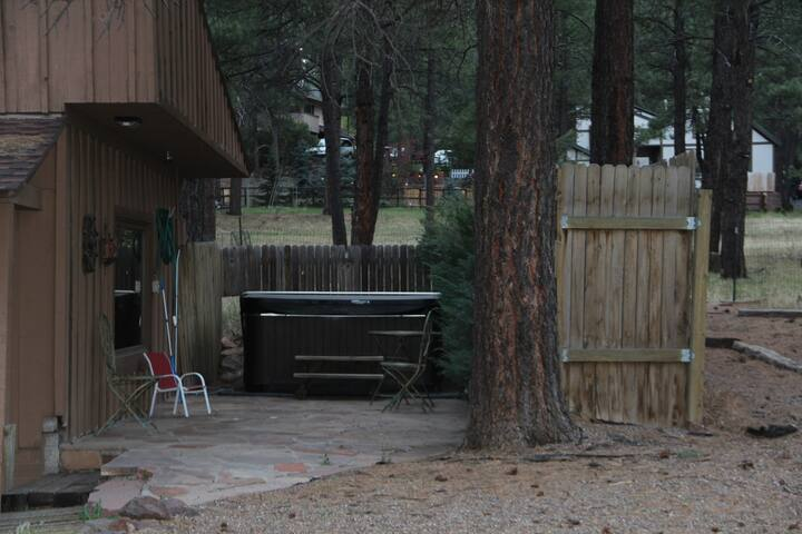 Hot tub in privacy enclosure