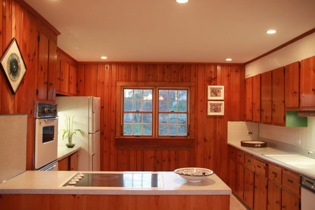 Kitchen with double oven, stainless steel dishwasher, window AC.
