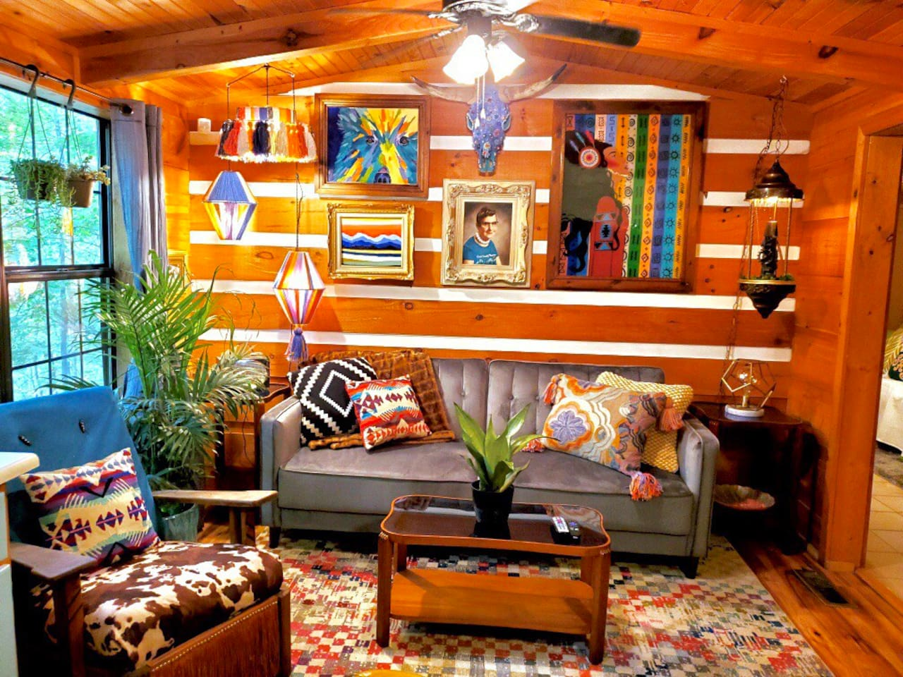 How fun is this living room?! Lots of colors, textures, antiques, and art by the owner.