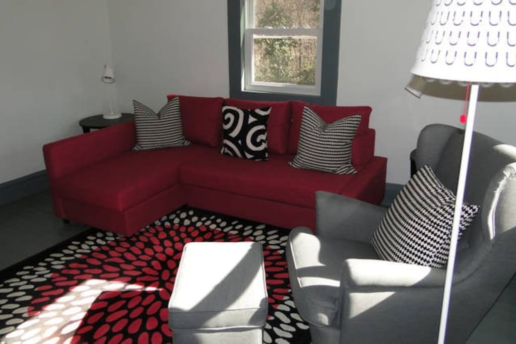 Living room at Swamp Rabbit Cottage furnished in IKEA, sofa bed