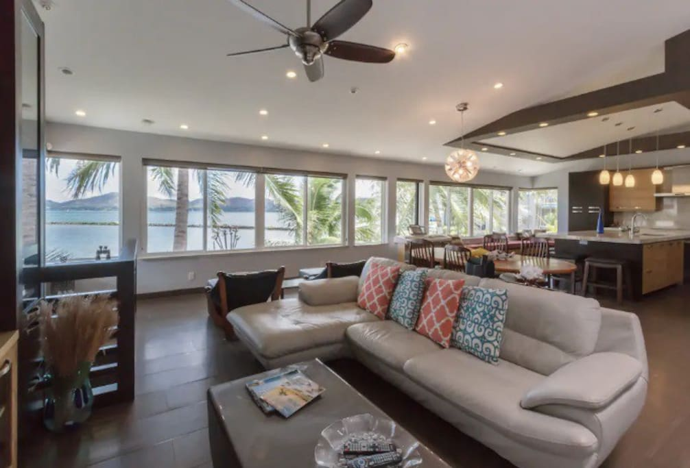 The home has an open floor plan and comfortable seating. Expansive views with wall to wall windows.