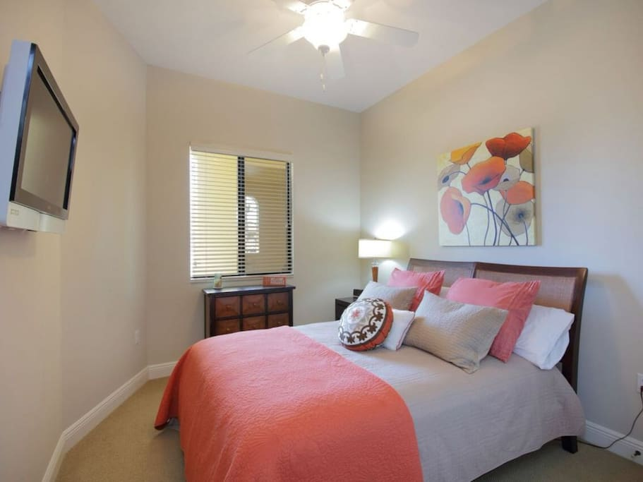Guest bedroom also displays custom designer touches with coordinating decor & queen size