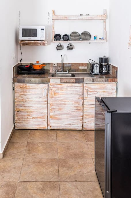 Kitchenette with microwave, mini fridge, electric stovetop, coffee maker and toaster
