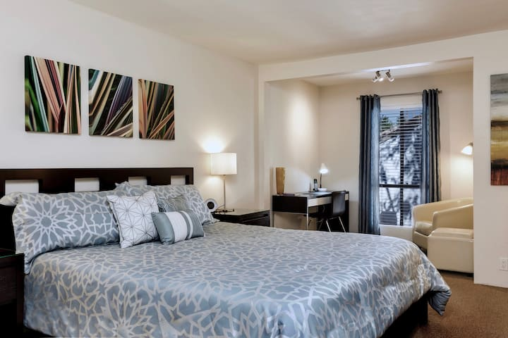 Large master bedroom with office area and king size bed