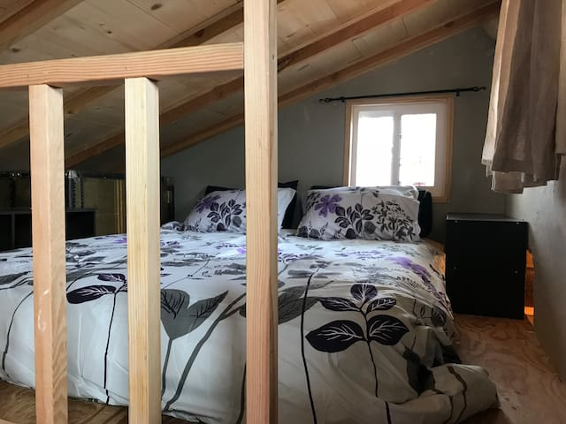 Queen bed in the loft.