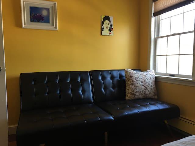 Couch in smaller bedroom