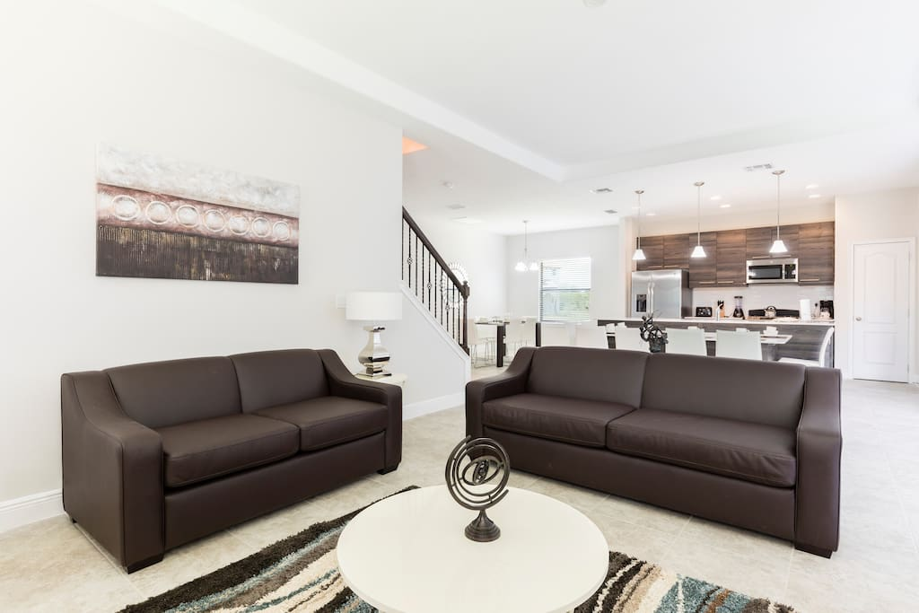 Sink into these comfortable sofas and catch a movie on the wall-mounted flatscreen TV.