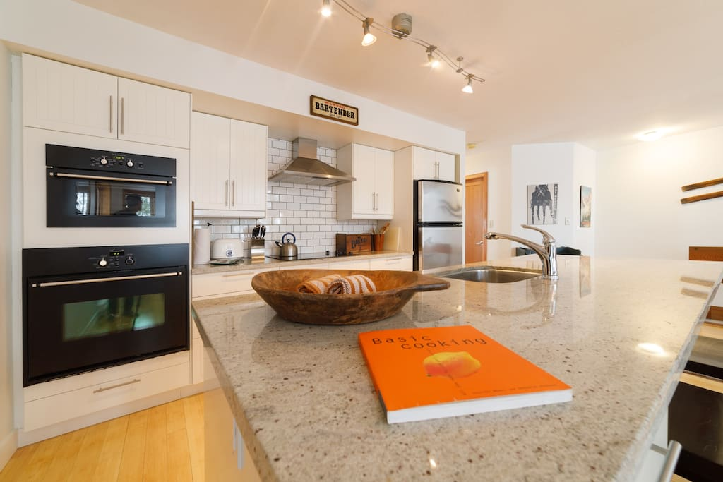 """You'll want to cook for your family in this kitchen! """"This place was perfect for our group: large open space living room and kitchen. """"- Sarah, Airbnb Guest"""