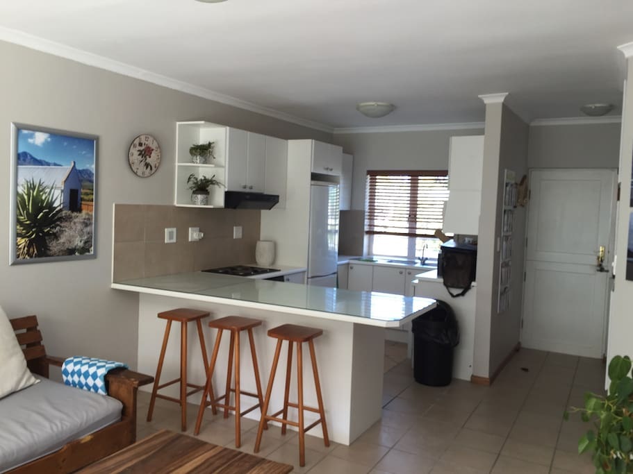 Fully contained kitchen with stovetop, oven, fridge/freezer, microwave oven and dishwasher.