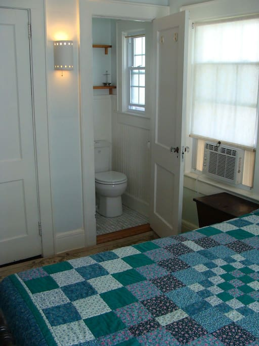 Private half bath -- shared full bath adjacent.