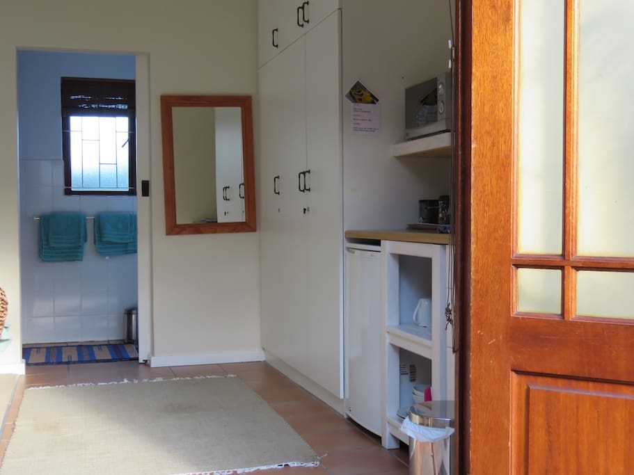 view to from entrance through to bathroom, with LARGE shower,basin,toilet