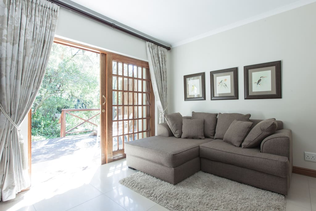 Guineafowl Suite: Spacious and comfortable sitting area leading onto picturesque garden deck
