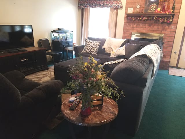 Downstairs/main floor living area. This is used by our family when we are home. Guests are also welcome to enjoy the Dish TV, Pure Flix,  card game (some guest even like to join our family game nights). Be mesmerized by the fish tank. Simply relax.