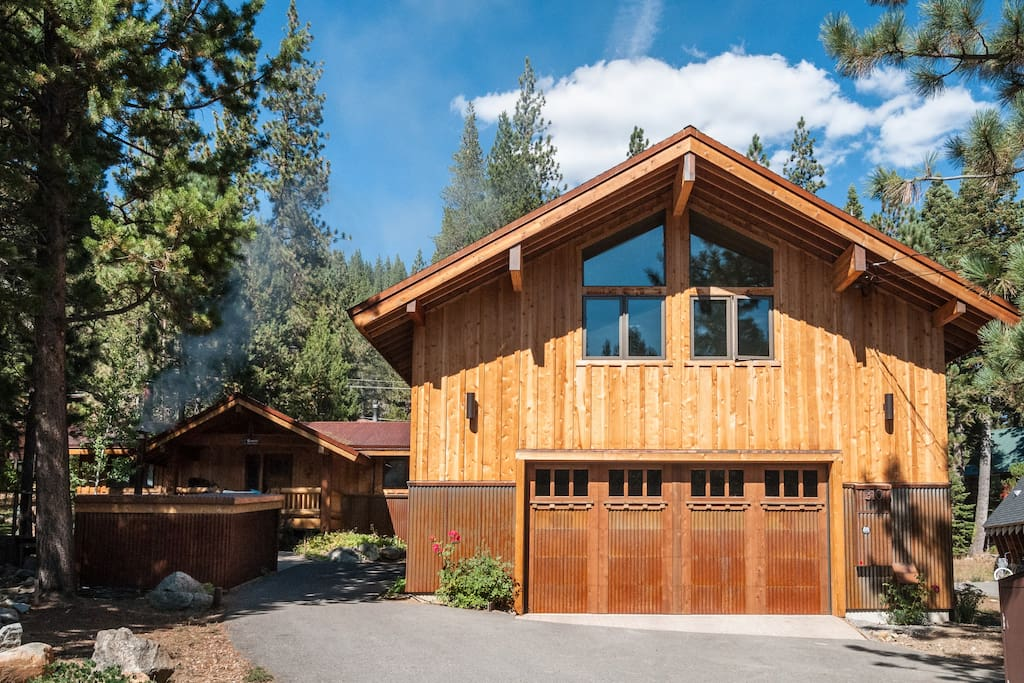 The large garage is a landmark on the property.  The ranch style home in the rear is the rental property.