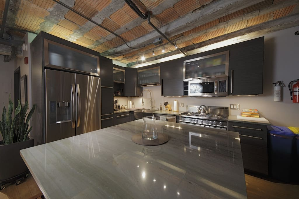 Gorgeous kitchen with intuitively laid-out custom-designed and built cabinetry.