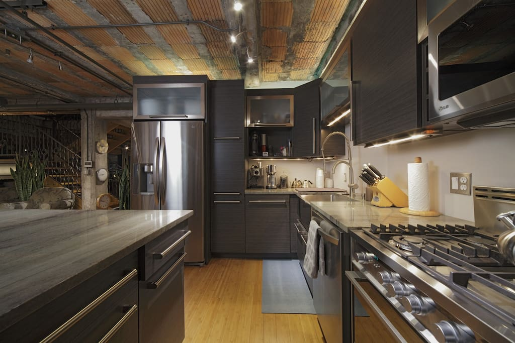 Gorgeous kitchen with fully-outfitted coffee station including tools for hand pour, french press, and electric drip. High-quality burr coffee grinder.
