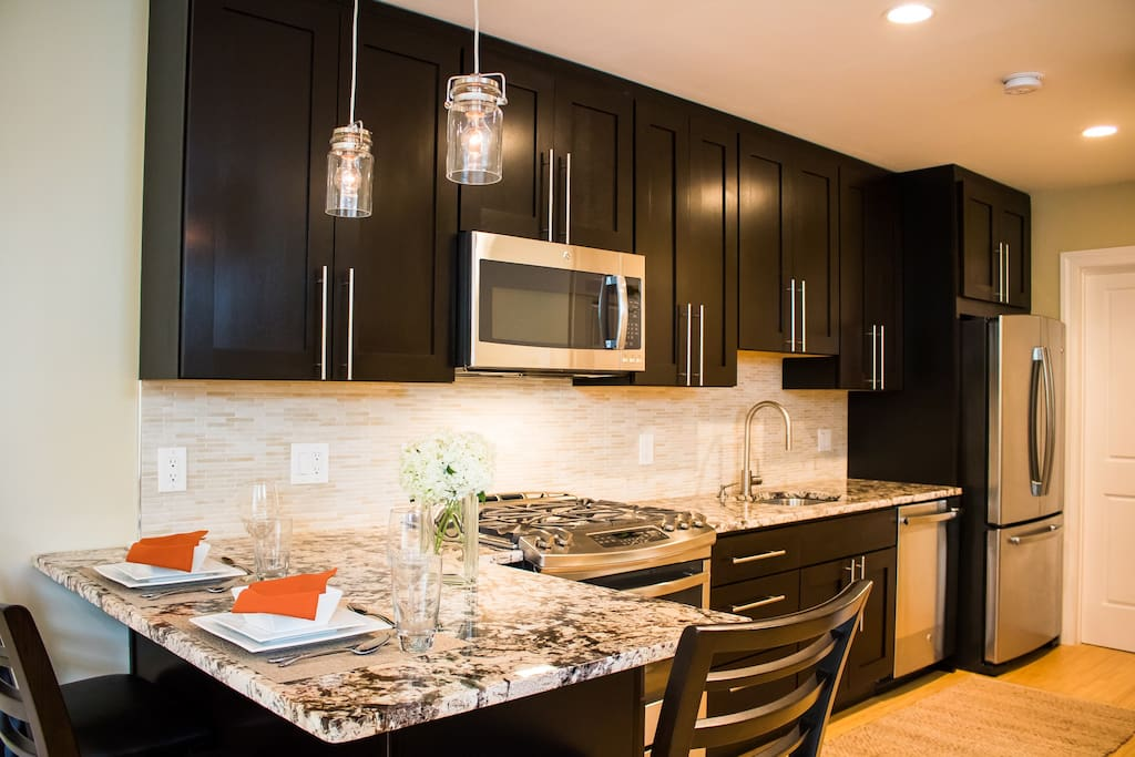 Kitchen and dining with high-end finishes.
