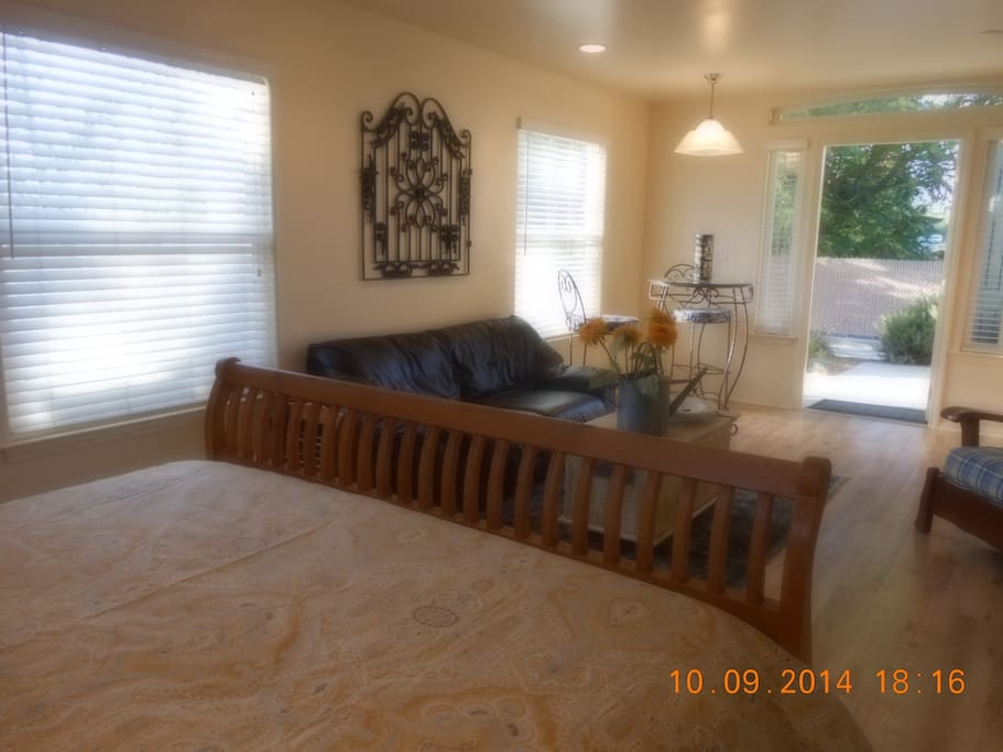 Queen size bed and vintage metal gate decor.