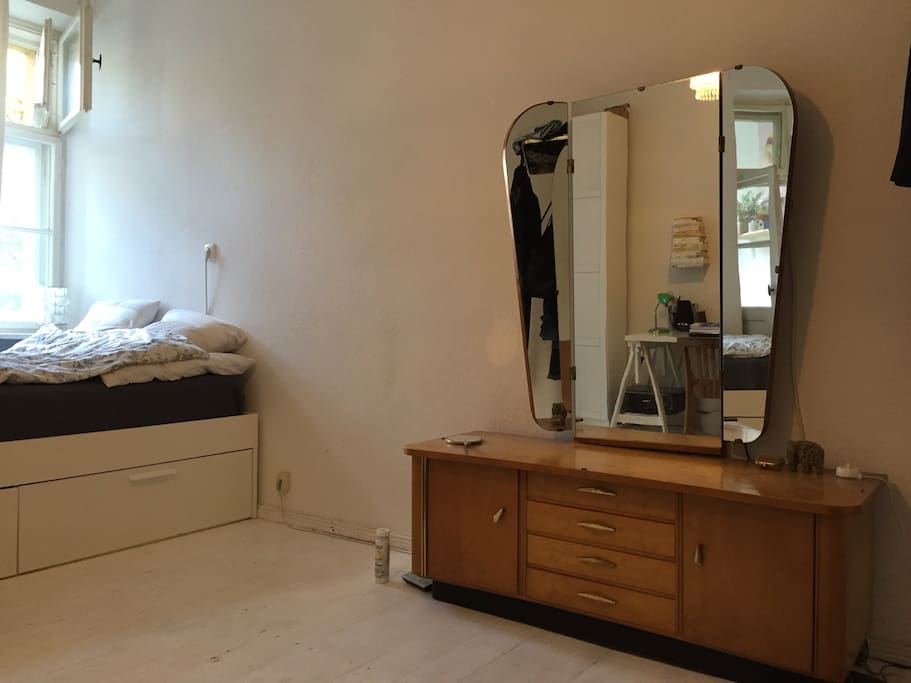 Old fashioned drawer with large mirror.