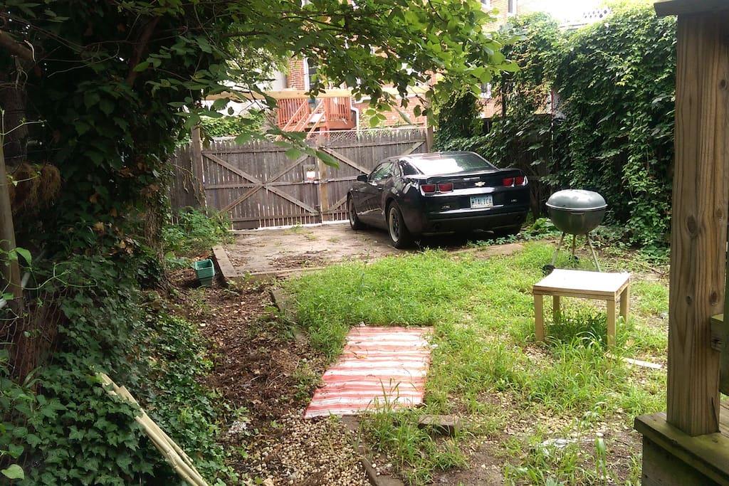 One parking spot in the backyard