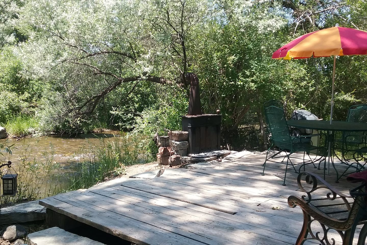 Open deck, fresh air, river lullaby, a peaceful spiritual retreat.