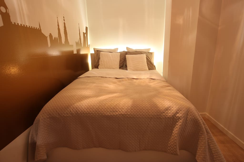 There is a variety of settings of light in the bedroom.