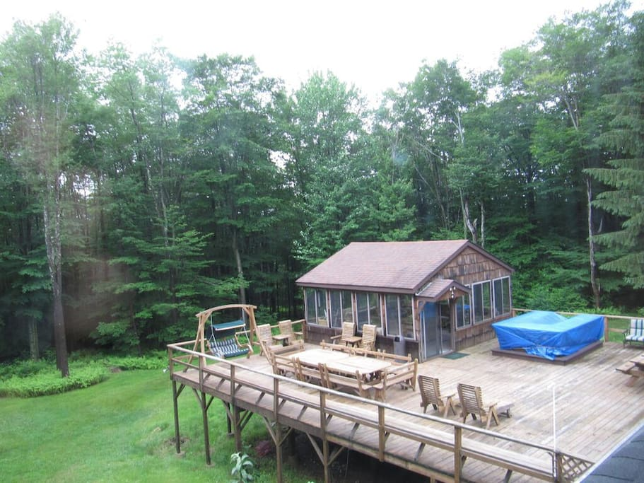 View of deck. Outside bar is covered with blue tarp.