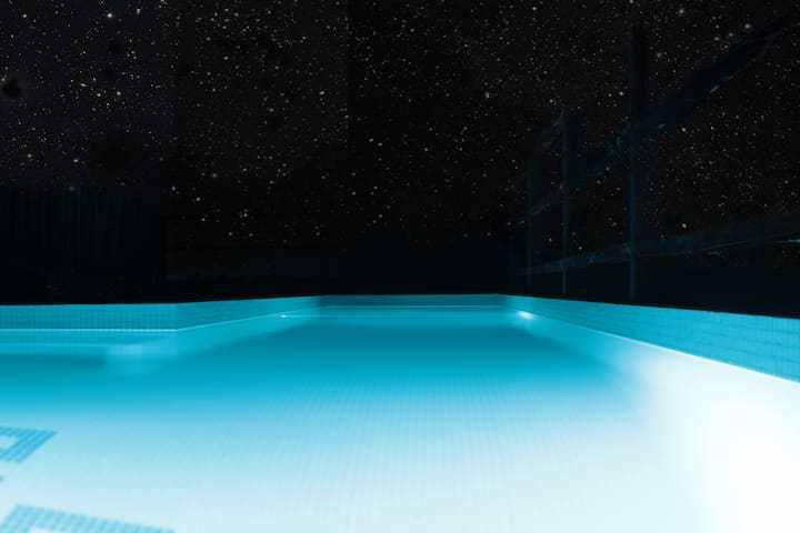 swimming under the stars in our sky pool. open 24 hours