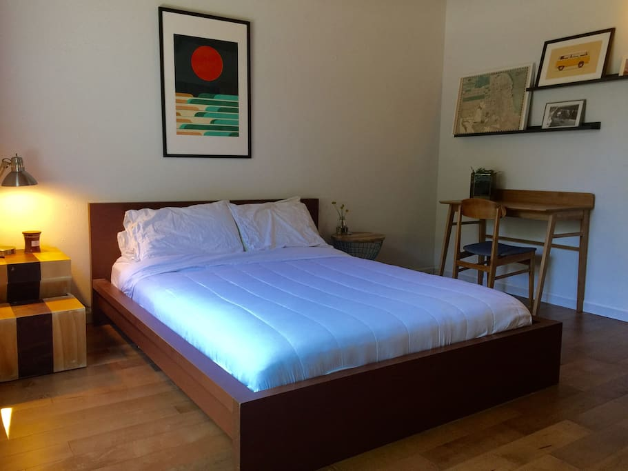 The bed is very comfortable...The side table was handmade by Emily while she attended RISD.
