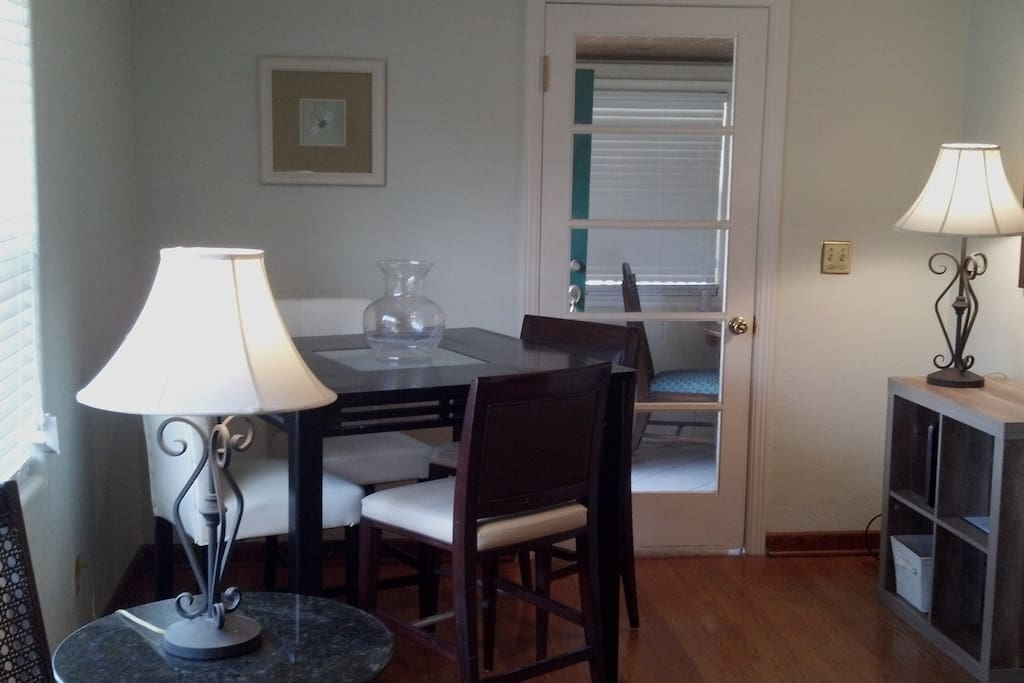 one of the dining areas in living/dining room.