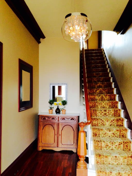 A grand foyer awaits before your cozy bedrooms.
