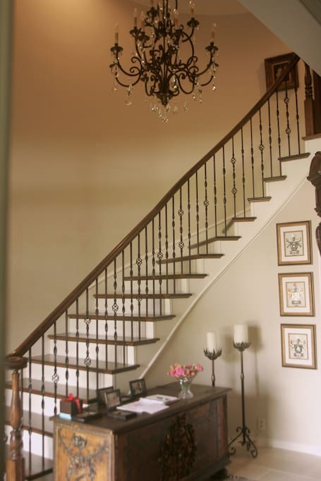 Entry Foyer with marble floor and dramatic lighting invite you as you enter the home.