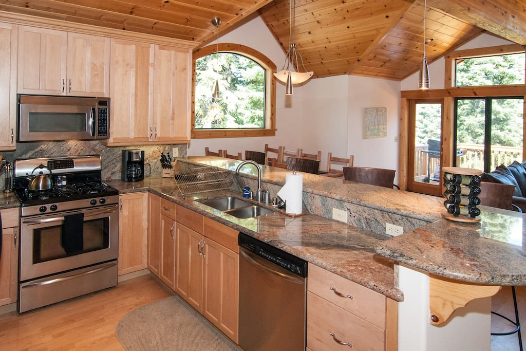 Modern, open kitchen with new 5 burner gas stove and new dishwasher