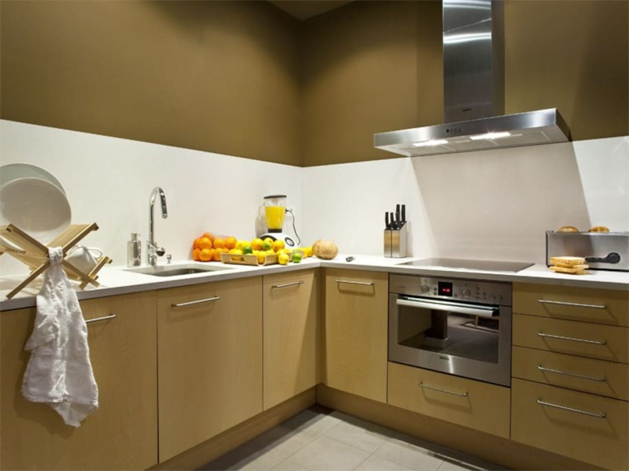 Open kitchen, fully equipped with high quality appliances and cooking utensils