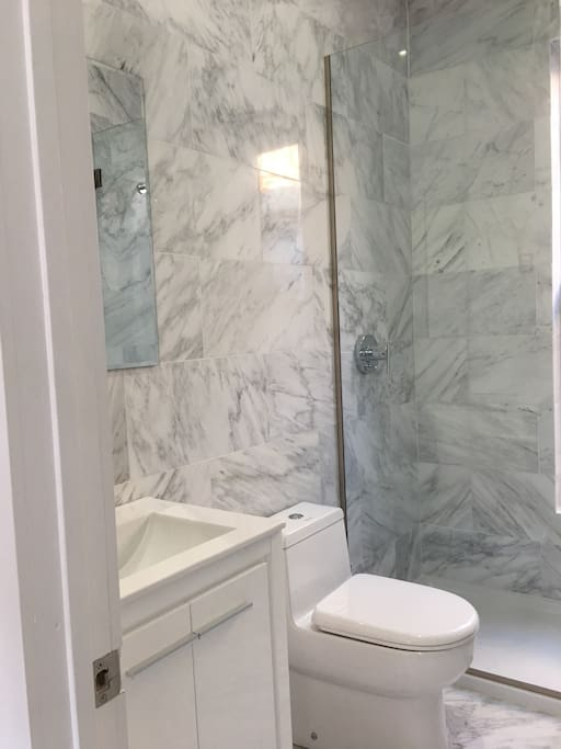 Bathroom with on demand never ending instant hot water. Super clean and brand new.