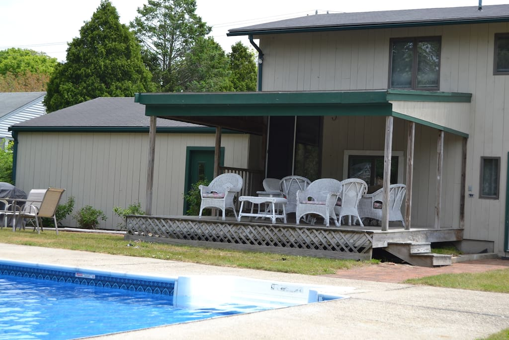 Plenty of room for everyone to relax on backyard deck overlooking pool.